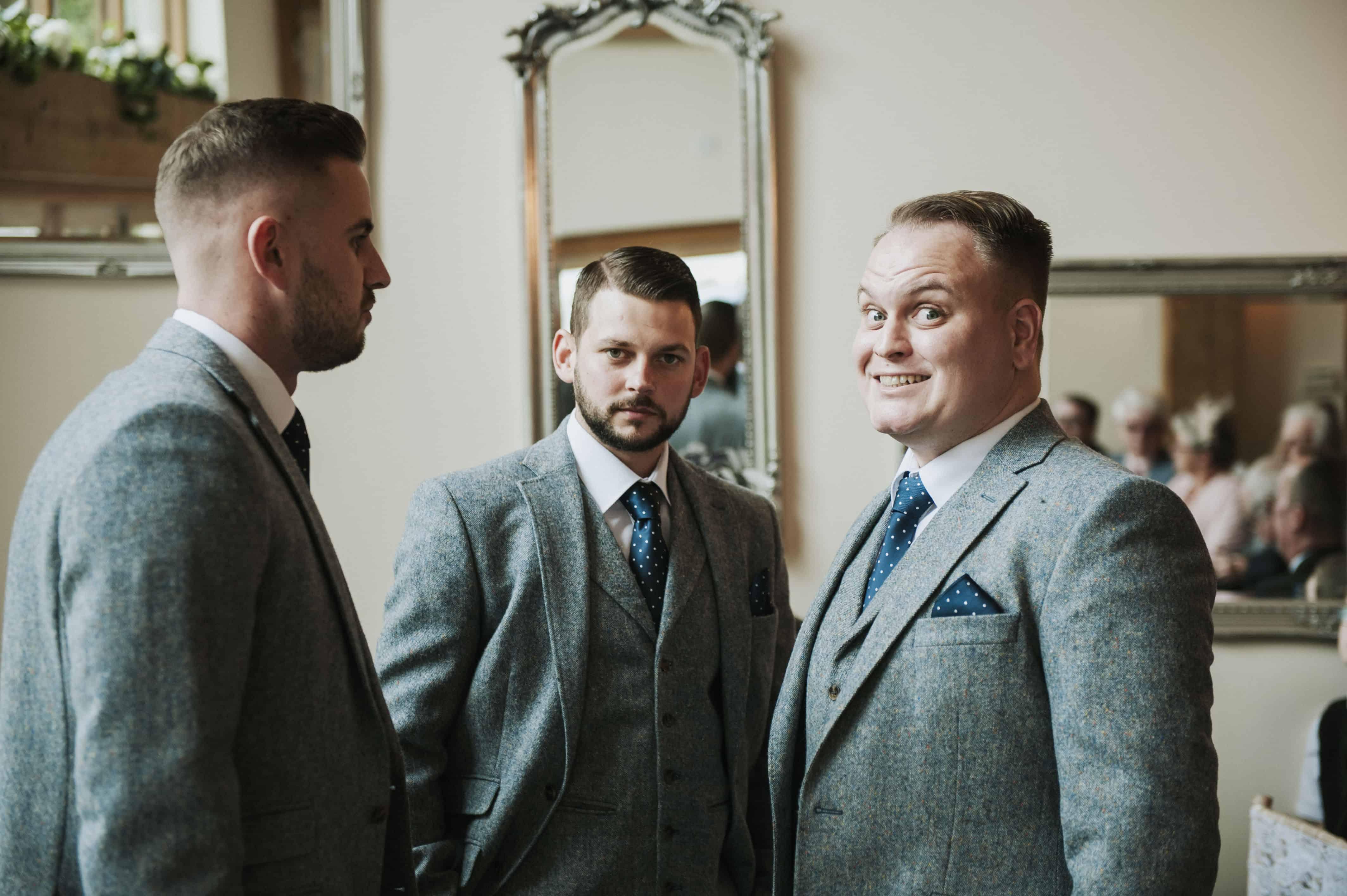 Groom and groomsmen looking at camera  Oldwalls Wedding Photographer