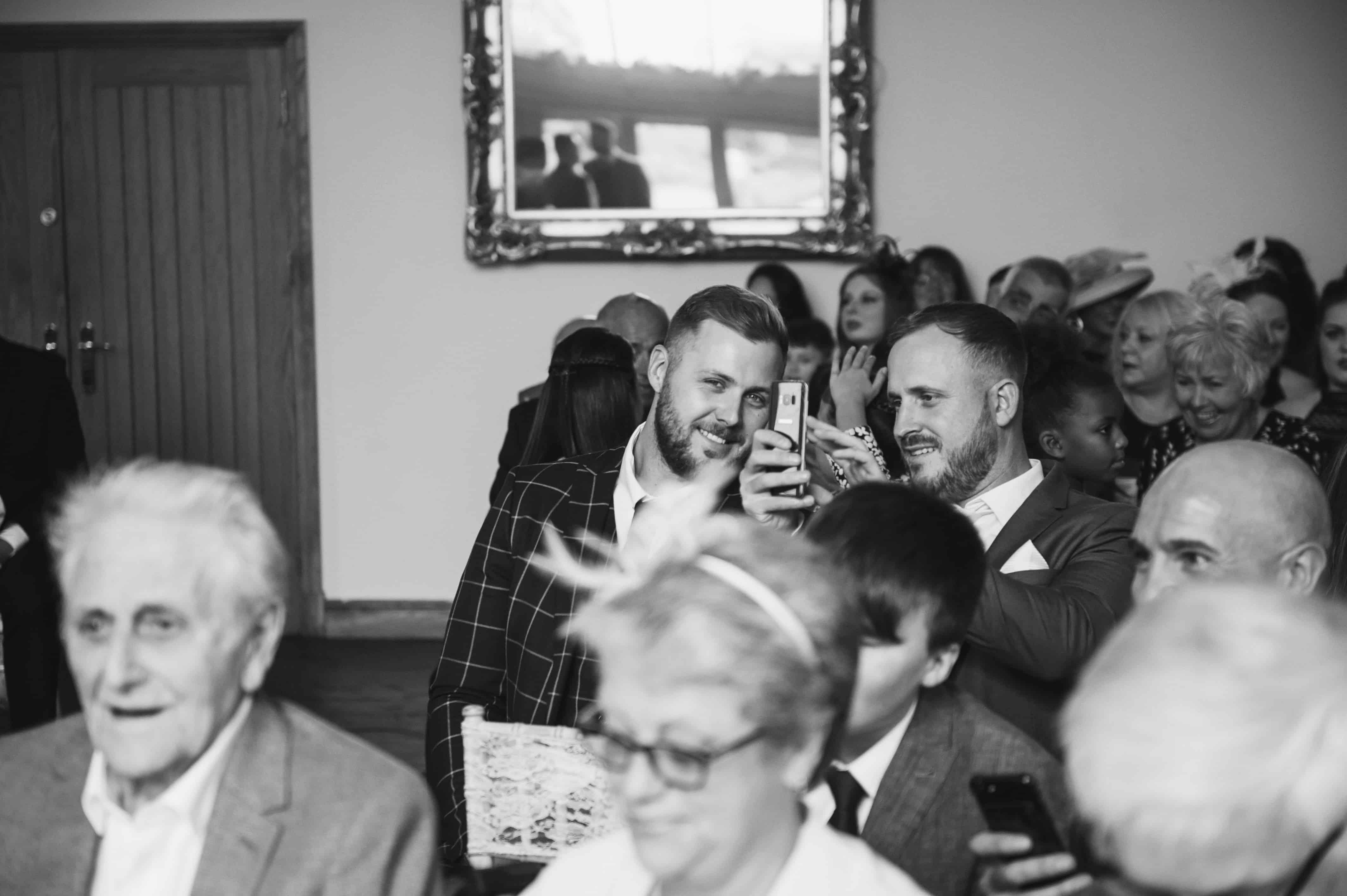 Wedding guests taking a selfie Oldwalls Wedding Photographer