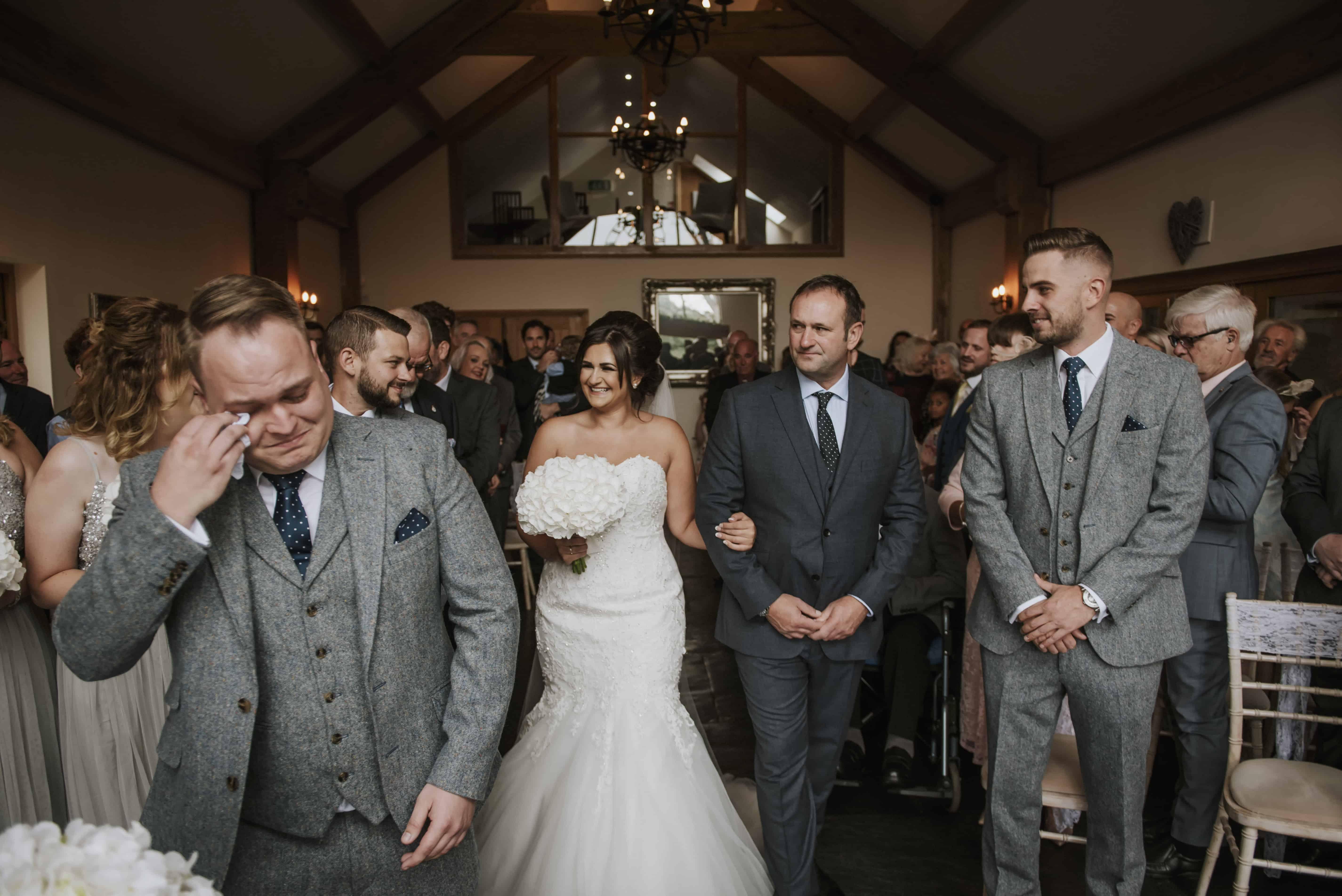 Groom crying at bride walks up aisle Oldwalls  Wedding Photographer