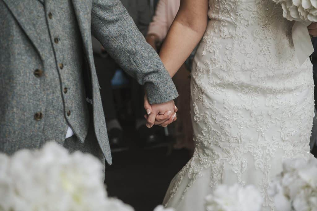 Close up of bride and groom holding hands Oldwalls Wedding Photographer