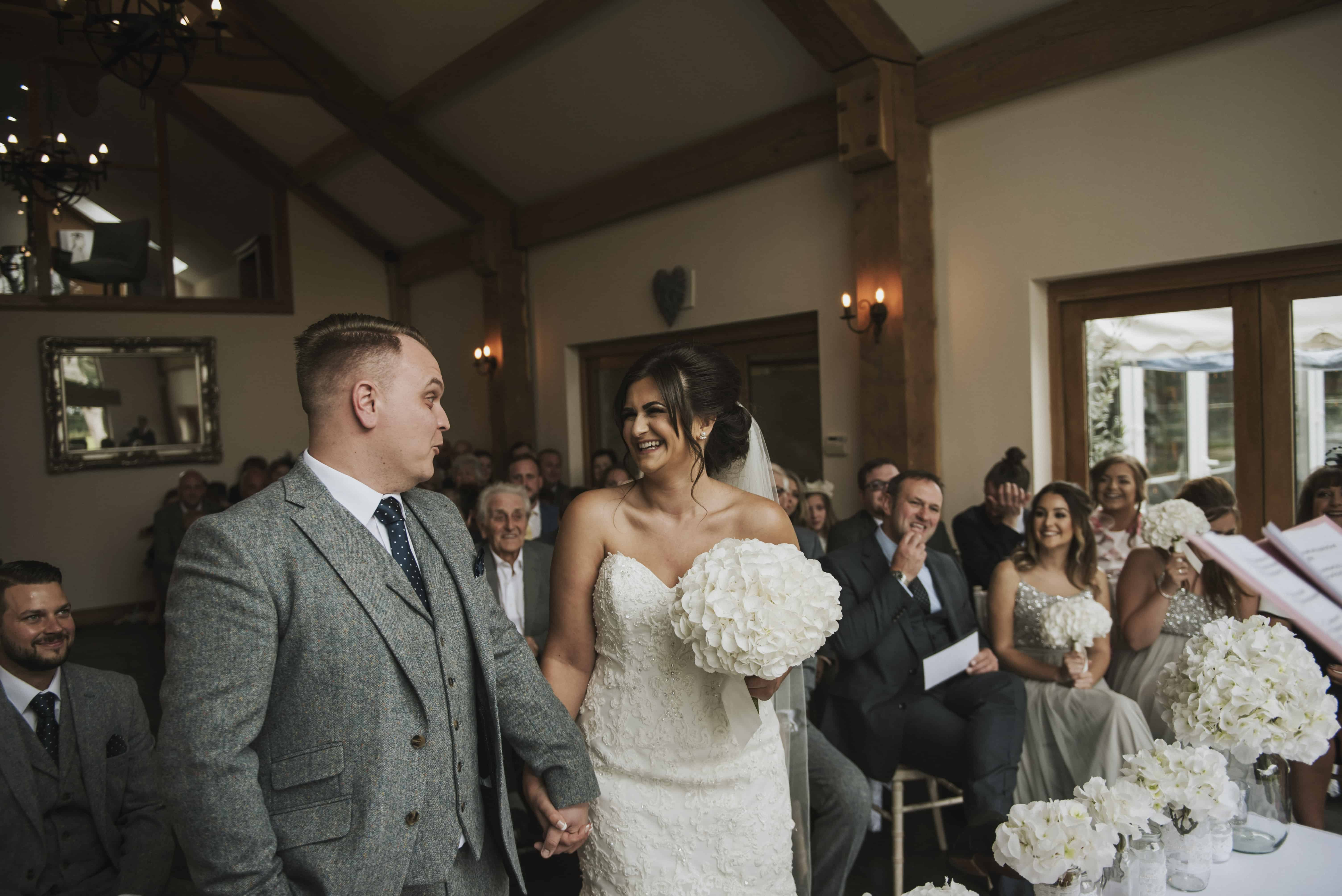 Bride and groom laughing during wedding ceremony Oldwalls Wedding Photographer