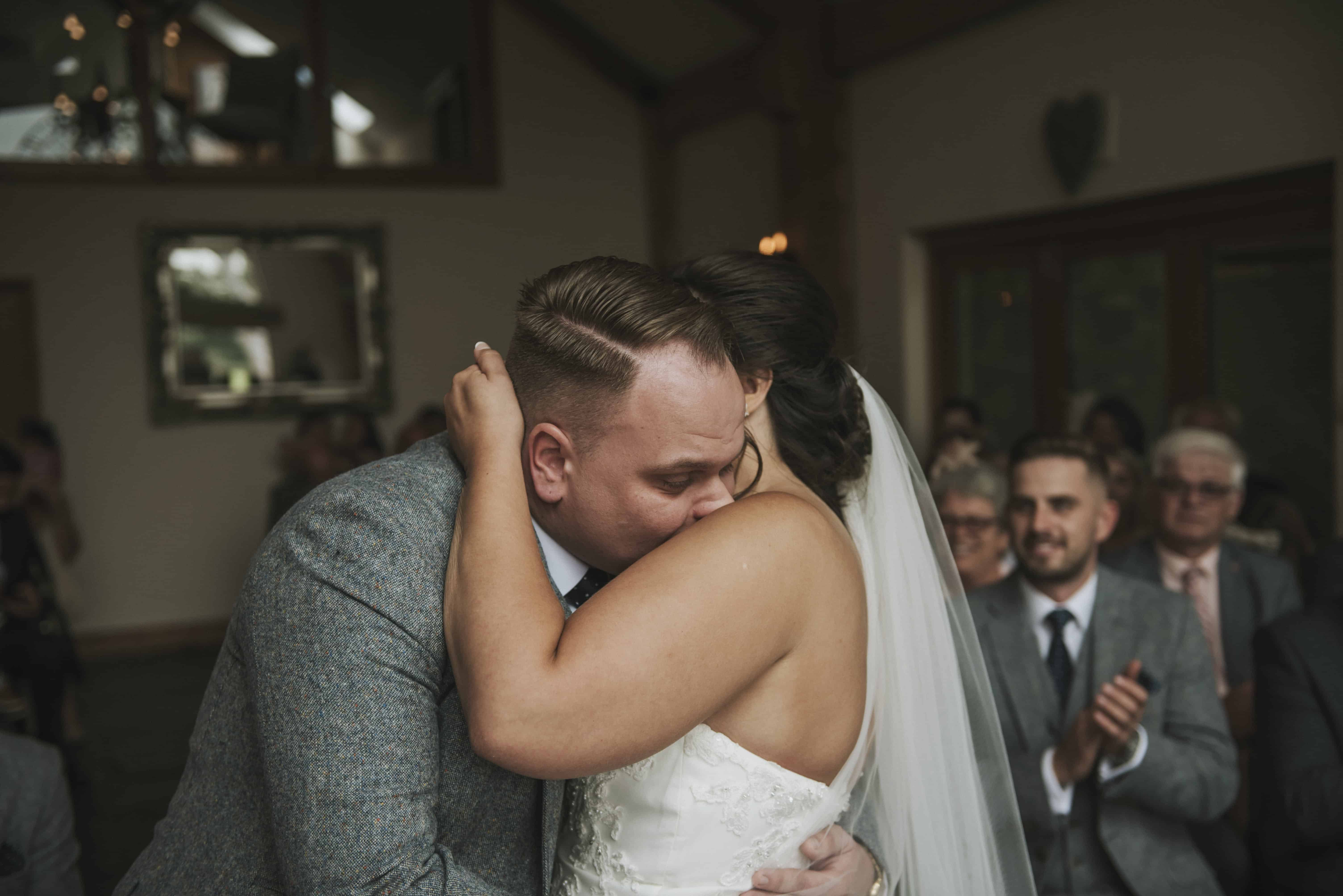 Bride and groom kiss during wedding ceremony Oldwalls Wedding Photographer