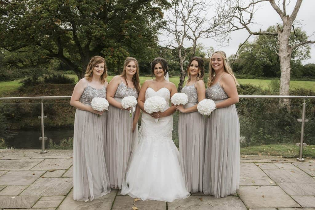 Bride & Bridesmaids holding bouquets Oldwalls Wedding Photographer