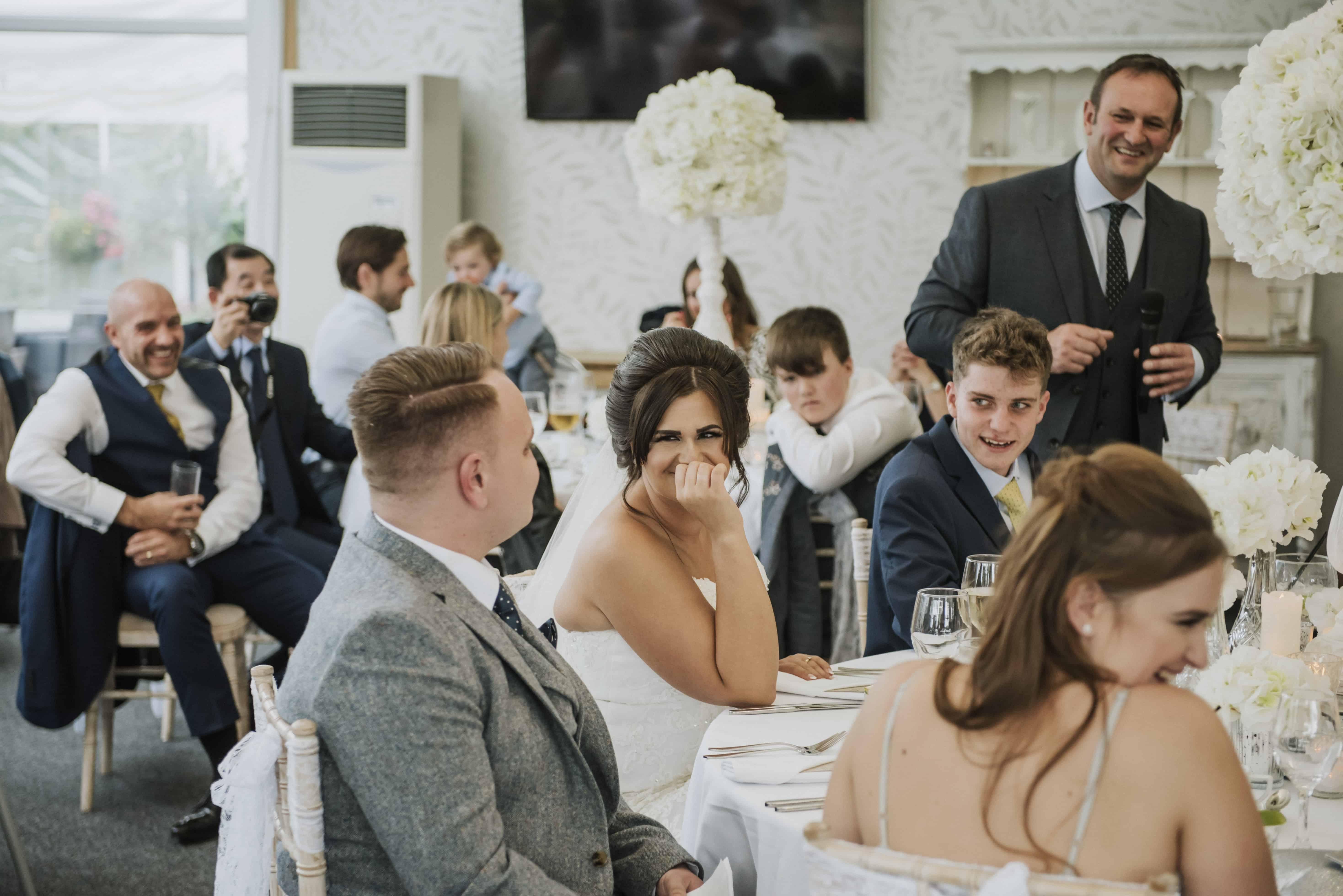 Bride laughing during wedding speeches Oldwalls Wedding Photographer