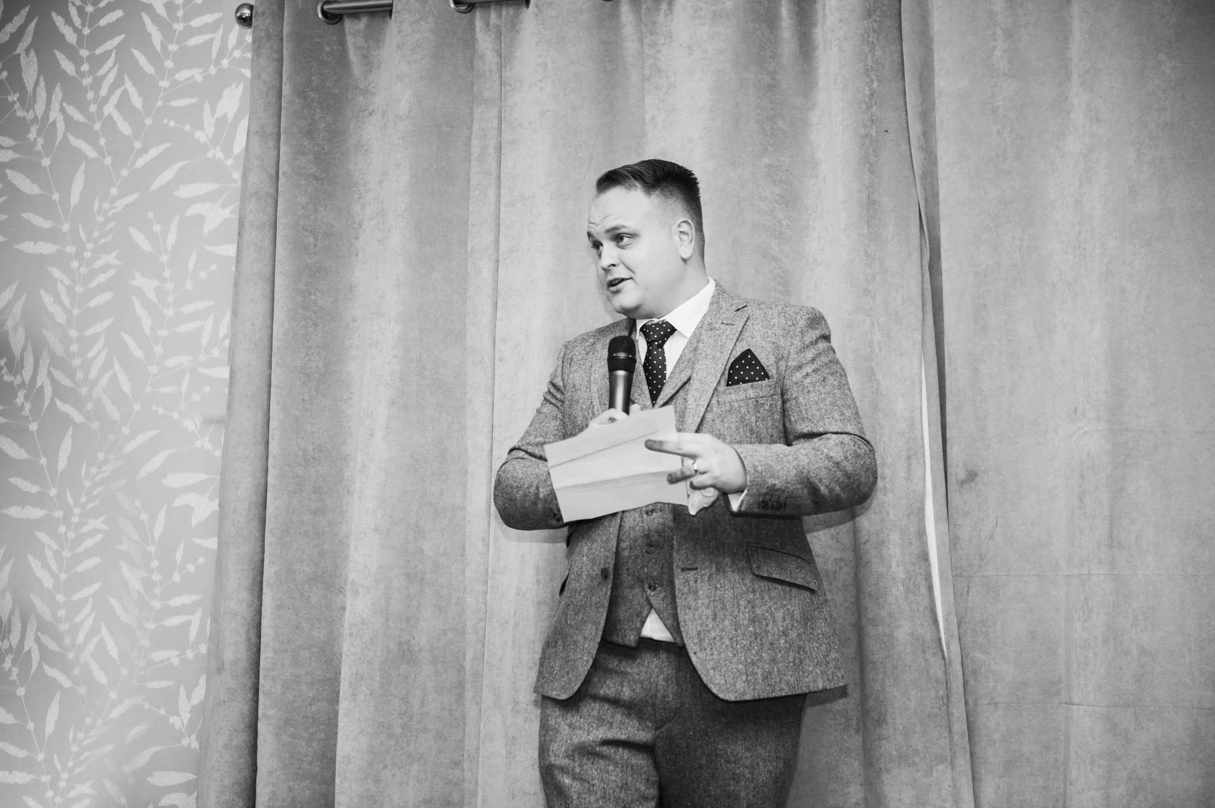 Groom speaking during wedding speeches Oldwalls Wedding Photographer