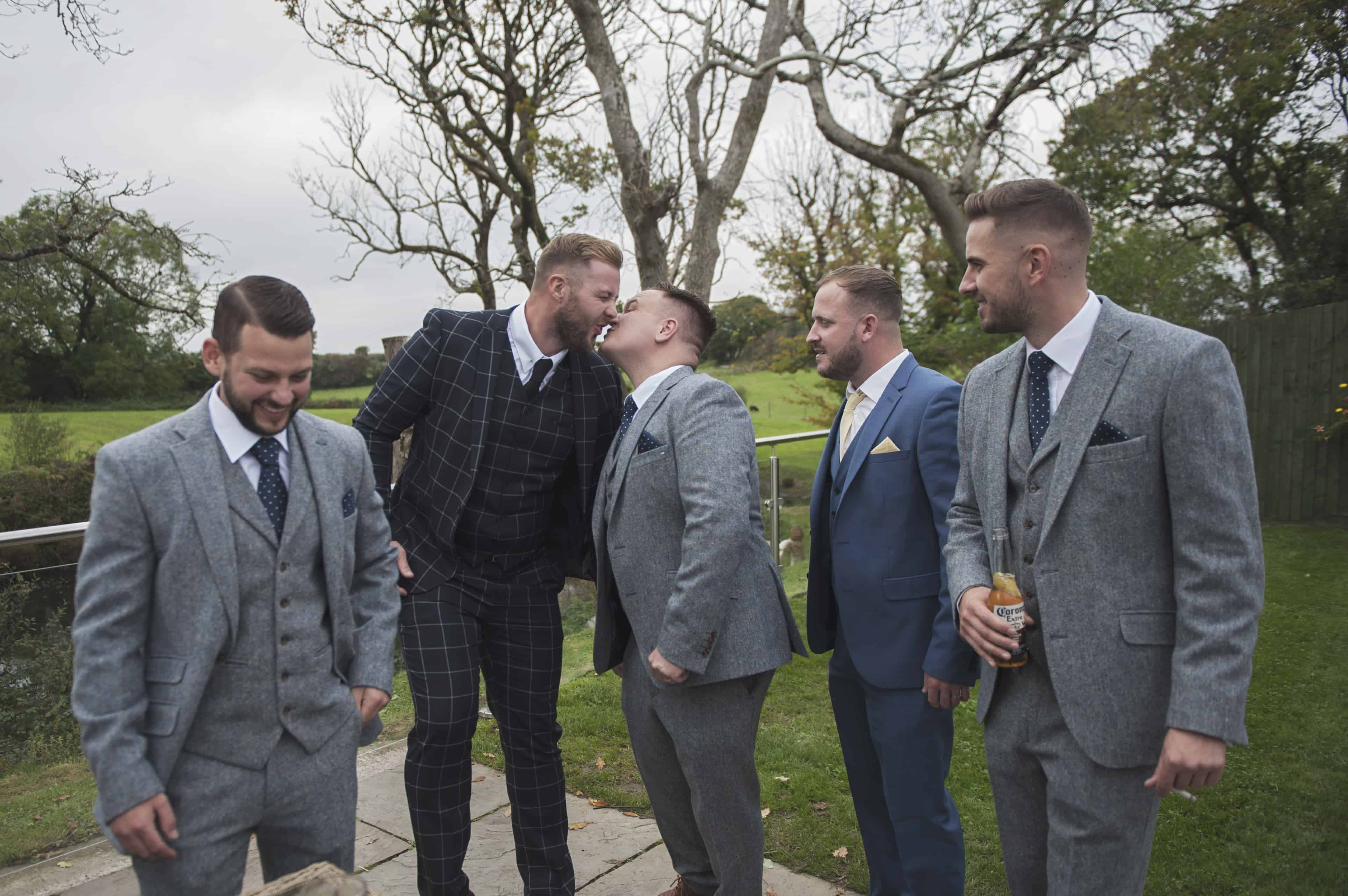 Groom and friends smiling  Oldwalls Wedding Photographer