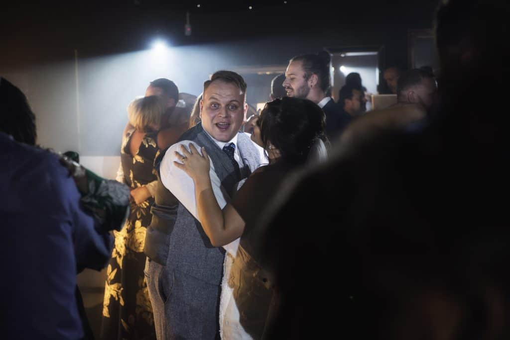 groom laughing on dance floor Oldwalls Wedding Photographer