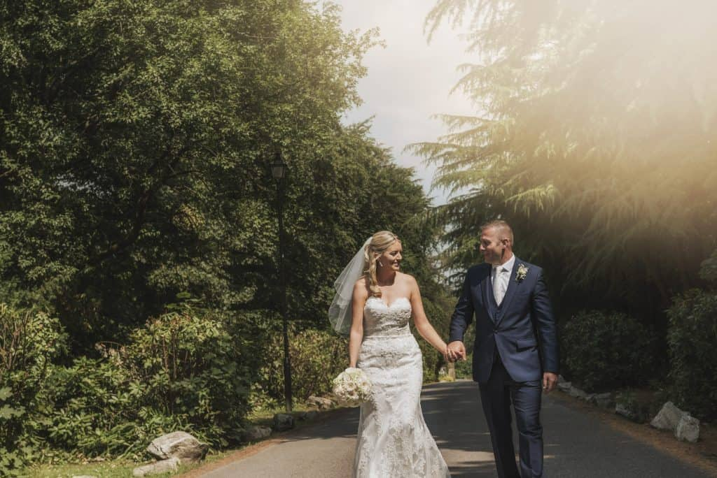 Maes Manor Hotel Wedding ~ Bride & Groom walking down tree lined drive way