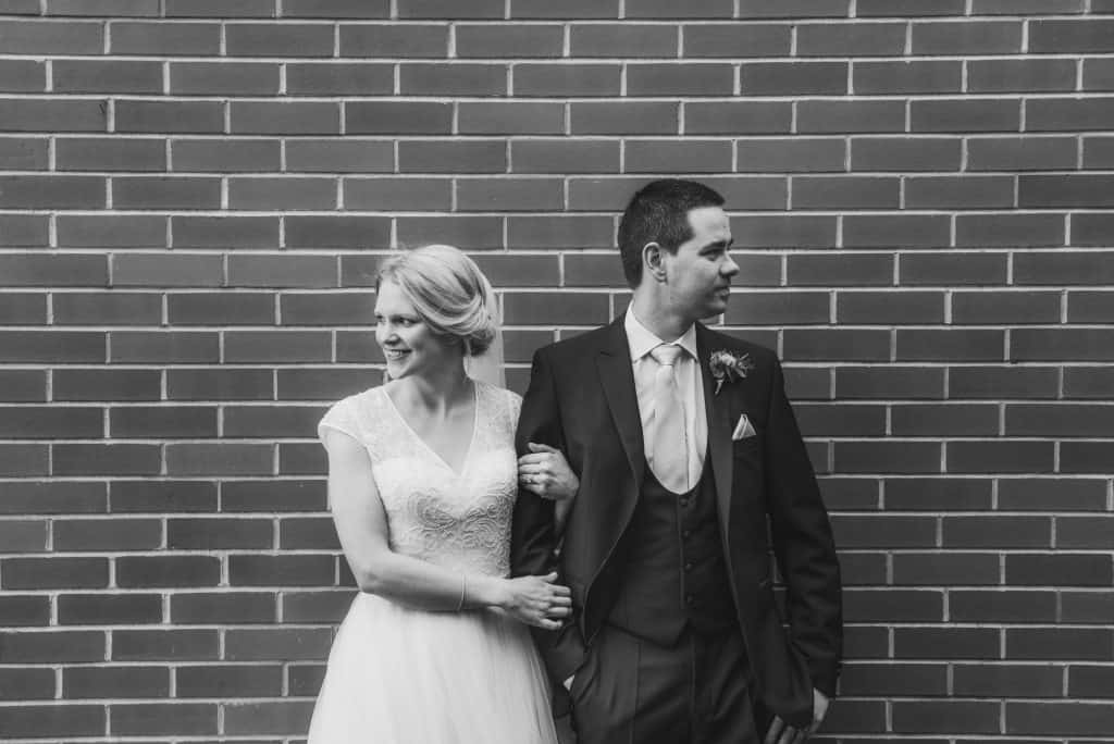 Holm House Wedding - Bride & Groom Stood in front of brick wall
